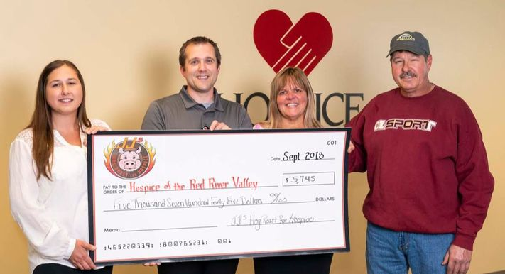 JJ's Hog Roast 2018 check presentation to Hospice of the Red River Valley